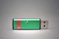 Usb flash drive with the national flag of turkmenistan on gray background. Royalty Free Stock Image
