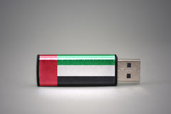 Usb flash drive with the national flag of united arab emirates on gray background. stock photography