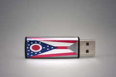 Usb flash drive with the ohio state flag on gray background. Stock Image