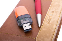 USB Flash Drive, pen and notebook Royalty Free Stock Images