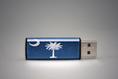 Usb flash drive with the south carolina state flag on gray background. Royalty Free Stock Image