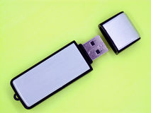 USB flash drive stick. On a florescent yellow background Royalty Free Stock Photography