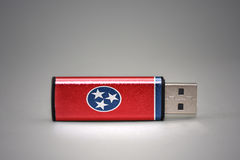 Usb flash drive with the tennessee state flag on gray background. royalty free stock images