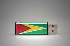 Usb Flash Drive With The National Flag Of Guyana On Gray Background. Stock Photos