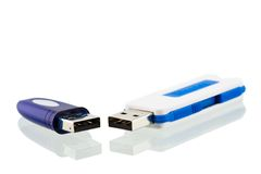 USB flash drives. Two USB flash drives and reflection on white Royalty Free Stock Photo