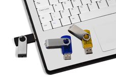 USB Flash drives and laptop Royalty Free Stock Photo