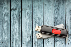 Usb flash drives. On the wooden background stock photography