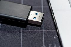 USB flash memory drive plugged into a computer laptop port. USB flash memory drive plugged into a computer laptop port stock photos
