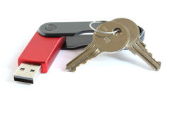 USB flash memory drive stick with keys. Red USB flash memory drive stick with silver keys isolated on white background Royalty Free Stock Image