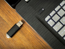 Usb flash memory and laptop Stock Images