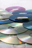 Usb flash memory on a pile of compact discs Royalty Free Stock Images