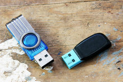 Usb flash memory. On rusty wooden background Royalty Free Stock Photos