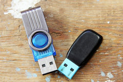 Usb flash memory. On rusty wooden background Stock Photos