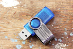 Usb flash memory. On rusty wooden background Stock Photography