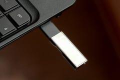 USB Flash Memory Stick Plugged on PC Stock Image