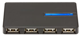 USB a hub 4x. Black usb a hub on four ports with a blue light-emitting diode stock photography
