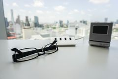 USB hub and modern digital clock with men glasses Royalty Free Stock Photography
