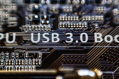 Usb 3 0 iscrizioni sul circuito di micro chip della scheda madre Fotografia Stock