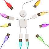 USB man and colorful plugs Stock Photos