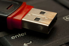 USB memory stick. Lying on keyboard closeup Royalty Free Stock Images