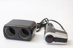 Usb negro del plástico y un cargador más ligero para el coche Imágenes de archivo libres de regalías