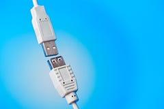 Usb plugs on blue Royalty Free Stock Photo