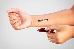 Usb Socket. Closeup Inserting usb flash drive into usb socket in arm Stock Image