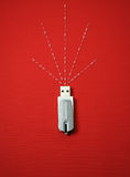 USB stick. Cose up of a USB stick with data flowing out Royalty Free Stock Photos