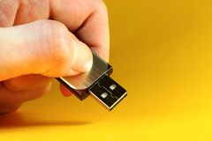 USB stick. Hand holding an usb stick Royalty Free Stock Images