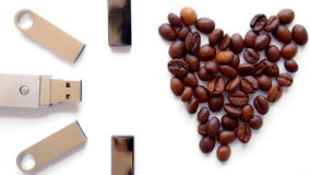 USB stick and heart from coffee beans on white background stock video footage