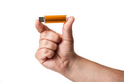 An USB stick hold between two fingers royalty free stock image