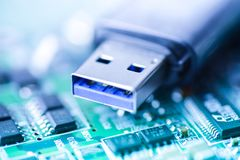 Usb stick motherboard blue backgrodun close up memory storage. Blurry Stock Images