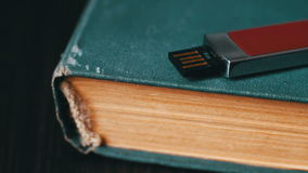 USB stick and old vintage book pages macro stock video