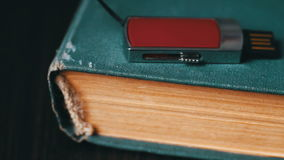 USB stick and old vintage book pages macro stock footage