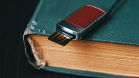 USB stick and old vintage book pages macro stock video footage