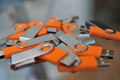 USB sticks. A lot of usb memory sticks lying on a table Royalty Free Stock Photography