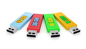 4 usb sticks with capacities. 3d usb memory sticks with capacities Royalty Free Stock Photo