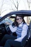 Uscendo dell'automobile Fotografia Stock