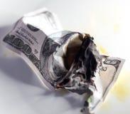 100 USD烧伤 库存照片