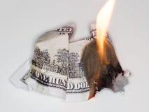 100 USD烧伤 图库摄影