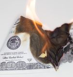 100 USD烧伤 免版税库存图片