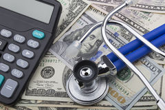 USD bank notes and calculator showing cost of health care Royalty Free Stock Image