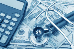 USD bank notes and calculator showing cost of health care Stock Photography