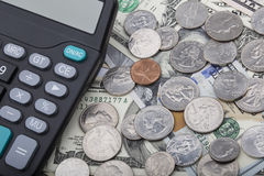 USD bank notes with coins and a calculator Royalty Free Stock Images