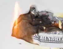100 USD-brandwond Stock Foto's