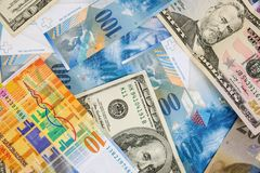USD and CHF banknotes as background. Background made of dollar and swiss franc banknotes Royalty Free Stock Photography