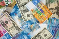 USD and CHF banknotes as background. Background made of dollar and swiss franc banknotes Stock Image