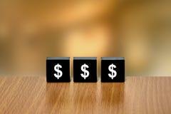 Usd Dollar auf schwarzem Block Stockbilder