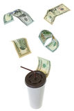USD dollar banknote money flying above white paper cup for coffe. E with brown lid and straw isolated on white background Royalty Free Stock Photo