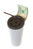 20 USD dollar banknote money leaving white paper cup for coffee. With brown lid and straw isolated on white background Royalty Free Stock Images